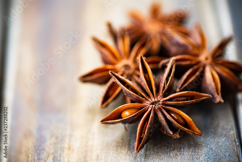 Fototapeta Close up of star anise on wooden table,herbs and spices, food ingredients obraz