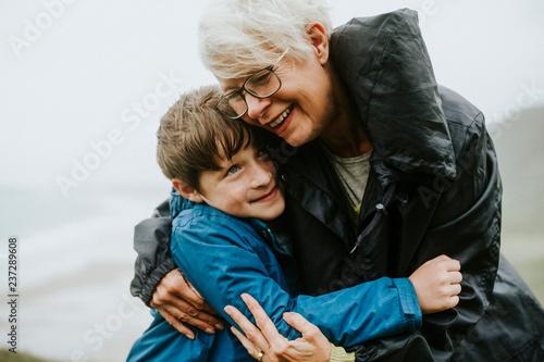 Happy grandmother hugging her grandson Wallpaper Mural