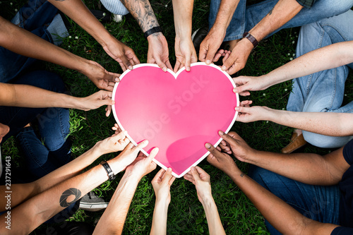 Fotografie, Obraz  Group of people holding a pink heart icon