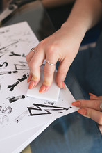 Close Up Of Anonymous Hands Making Homemade Rubber Stamps