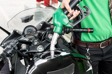 Person Hand Refilling Gas To The Motorcycle Barrel Tank.