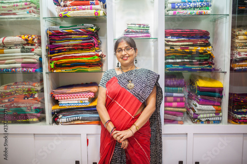 879d6dd0ef A Businesswoman who sells traditional Indian dress in a small shop ...