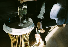 Glasses Of Champagne Or Sparkling Wine On A Table In A Shaft Of Sunlight.