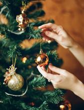 Person Decorating Christmas Tree