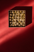 Box With Golden Small Christmas Balls
