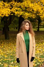 Young Woman Enjoys Autumn
