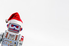 Vintage Robot Retro Classic Toy With Christmas Hat On White Background