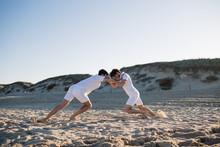 Men Shuffling On Sand