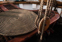 A Rolled Rope Or Rope On A Wooden Deck Of An Old Ship