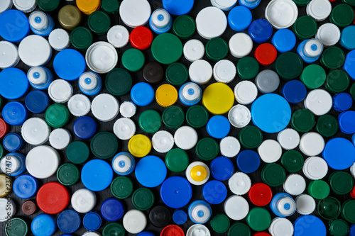 Collection of various colorful plastic screw caps #237317476
