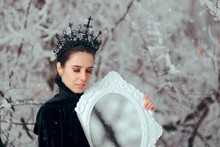 Evil Queen With Magic Mirror In Winter Wonderland