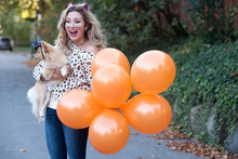 A Teenage Girl And Her Dog Dressed Up For Halloween