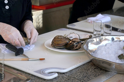 cook prepares seafood, oysters, shells