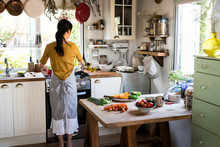 Japanese Woman Cooking In A Co...