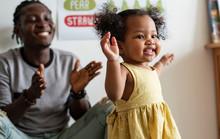 Happy Girl And Teacher Having Fun In Nursery