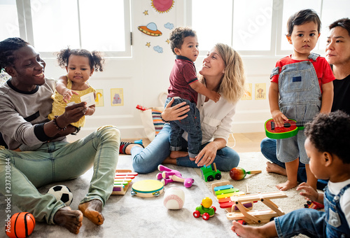 Fotografie, Obraz  Diverse children enjoying playing with toys