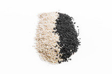 Black And White Sesame Seeds On A White Background, Isolated Top View