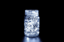 White Fairy Light In A Mason Jar, In The Dark, Low-key Photography