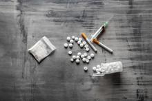 Syringe With Drugs On Grey Bac...