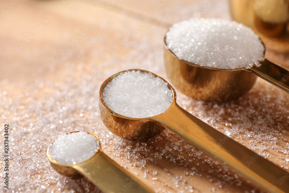Fototapety, obrazy: Spoons with refined sugar on wooden background