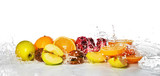 Fresh fruits with splashing water on white background