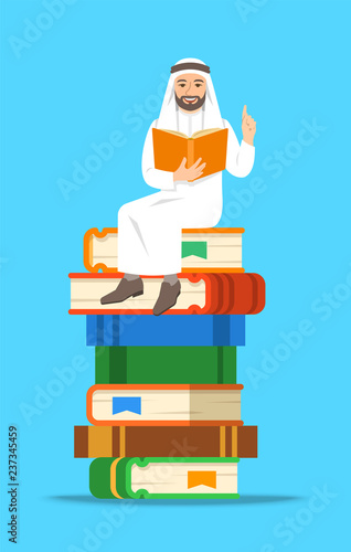 Young arab man teacher reads open book sitting on stack of