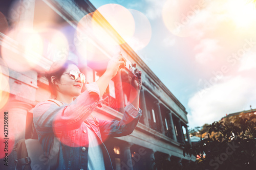 Foto op Canvas Aziatische Plekken Young woman traveling on Stanley Market in Hong Kong with bokeh light effect