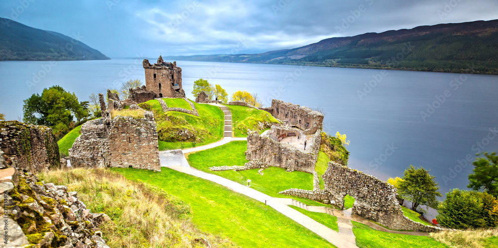 Fototapety, obrazy: Urquhart Castle with Dark Cloud Sky and Loch Ness in the Background