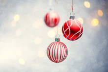 Photo Of Three Christmas Red Balls On Gray Background With Spots.