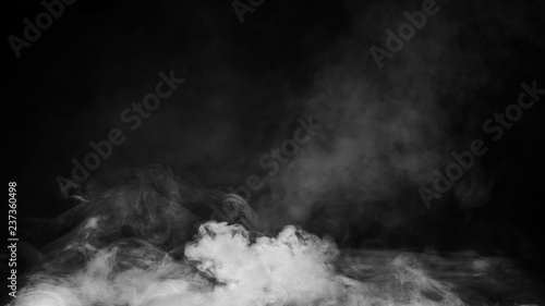 Fototapety, obrazy: Smoke on floor . Isolated black background . Misty fog effect texture overlays for text or space
