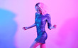 canvas print picture - Sexy woman in Party outfit dance. Music vibrations