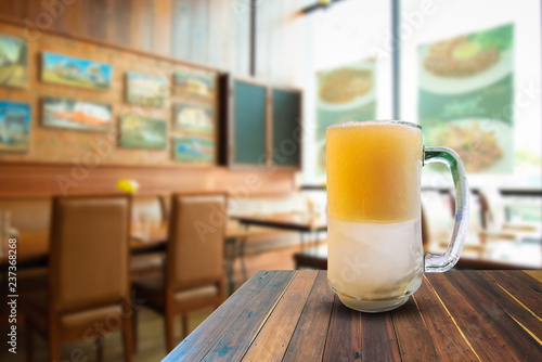 Staande foto Bier / Cider Beer on wooden table in bar and space text.