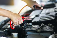 Hand Man Charging Car Battery ...