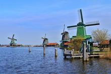 Green Windmills In Zaanse Schans Near The River Zaan. Zaanse Schans, The Netherlands.