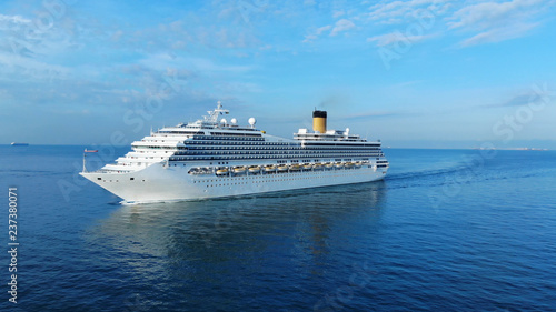 Fototapeta Aerial view of beautiful white cruise ship above luxury cruise concept tourism travel on summer holiday vacation time. obraz