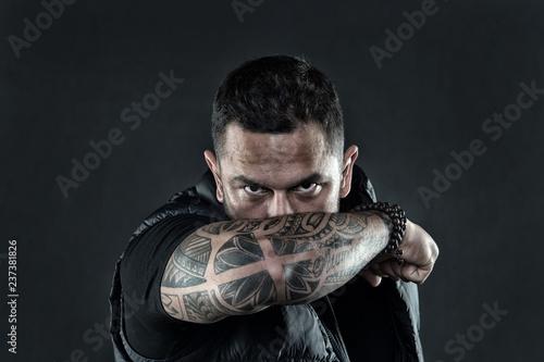 Fényképezés  Tattooed elbow hide male face