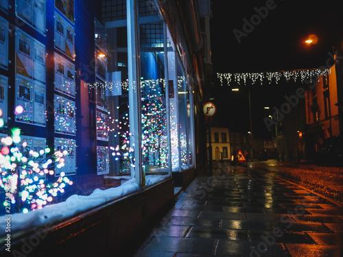 Fototapeta rainbow christmas tree reflections in window obraz na płótnie