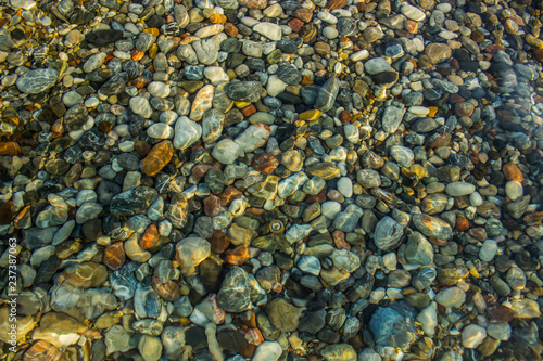 abstract unfocused fuzzy underwater colorful stones background sea bottom concep Wallpaper Mural
