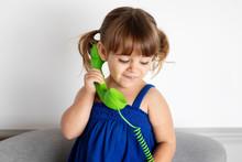Little Girl Listening To Green...