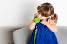 Little Girl Talking On Green Corded Phone