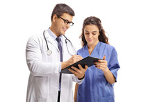 Male Doctor And A Nurse With C...