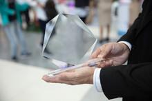 Hand Man Holding Award