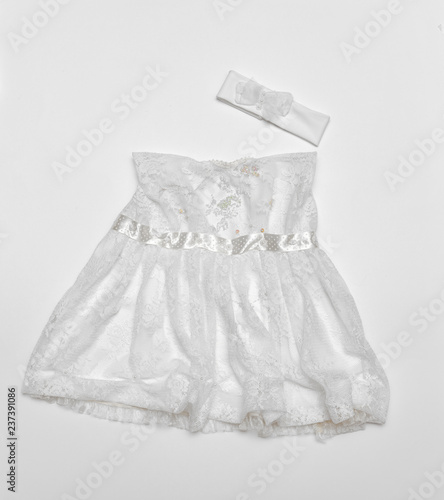 55076b23c5e0 baby dress on white background - Buy this stock photo and explore ...