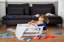 Toddler Playing In A Laundry B...