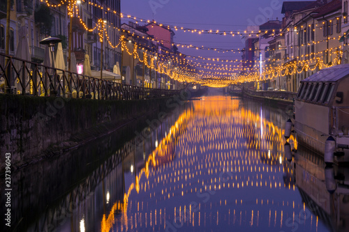 Fotomural Night view of Naviglio Grande canal waterway in Milan, Italy