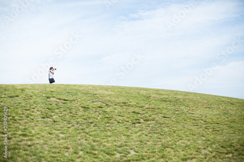 A photographer on top of a hill in Summer