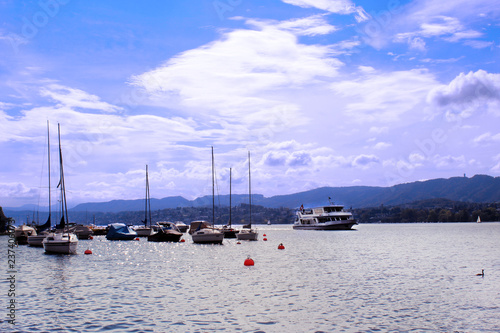 Photo sur Aluminium Antarctique Boats blue sky and clouds. Picture of boats, water transport, ocean transportation.