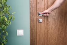 Open The Door. Hand On Door Handle. Close - Up Elements Of The Interior Of A Beautiful Apartment