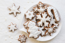 Christmas Cookies On A Plate, Decoration In The Shape Of Snowflakes And Stars On A White Background. Top View.