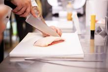 Chef Slicing Duck Breast In Kitchen Restaurant. Meat Preparation